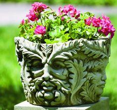 A fun planter with faces...