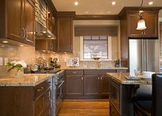 kitchen with dark brown cabinets. I like the under cabinet lighting.