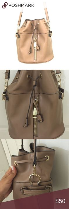 Nude ZARA bucket bag As new, barely used it. Has a big gold zipper in front. Zara Bags Crossbody Bags