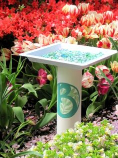 The secret ingredients of this DIY birdbath are PVC pipe & a plastic tray.