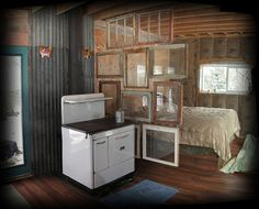Super cute window wall panorama to separate living spaces in a very tiny home in Idaho.