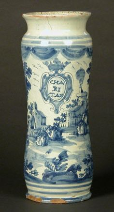 Albarello*, Ceramic, 1726.  Savona blue-and-white Albarello decorated with landscape and cartouche inscribed 'CHARITAS'. The reverse dated 1726. *a type of maiolica earthenware jar, originally a medicinal jar designed to hold apothecaries' ointments and dry drugs
