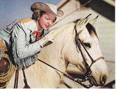   Dale Evans Wife of Roy Rogers and Buttermilk Quarter Horse used in their TV show.