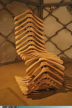 wooden hanger chair - so original. Looks like a spine!