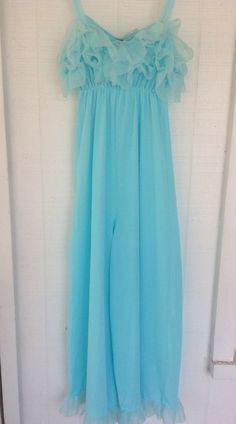 Adorable Blue 1960's one piece Jumpsuit made of 100% nylon! Such a fun piece with lots of Ruffles! It has sheer straps and sheer ruffle bodice with an elastic waist and wide, cropped length legs with ruffle cuffs. | eBay!