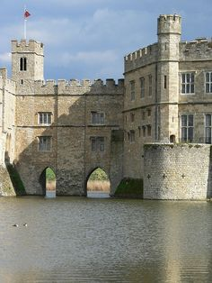 William the Conqueror used enforced Anglo-Saxon labour for work on the construction of Leeds Castle. The original wooden castle was replaced by a fortified stone castle in 1119. An important feature of Leeds Castle is its access to the River Len. Leeds Castle occupies three islands surrounded by an artificial lake. King Henry VIII converted Leeds Castle into a Royal Palace but retained the defences due to the possible risk of invasion from Spain or France.