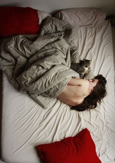 sleeping in. cuddling with cat.