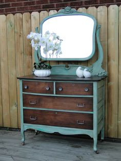 I tried a new technique on this dresser to get the variegated green that is…