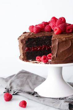 Chocolate-Raspberry Layer Cake This chocolate cake is moist, delicious, and vegan friendly! It has a generous layer of a raspberry chia filling in the center and a fluffy chocolate frosting! Gluten and refined sugar free variation included. Chocolate Raspberry Cake, Vegan Chocolate, Chocolate Cake, Chocolate Frosting, Strawberry Cakes, Whipped Ganache, Lemon Layer Cakes, Lemon Cakes, Cake Recipes