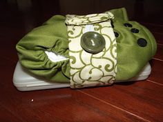 Wipes case and diaper strap