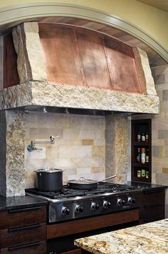 stone and copper range hood