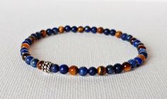 Check out this item in my Etsy shop https://www.etsy.com/ca/listing/516392661/4mm-lapis-lazuli-bracelet-tigers-eye