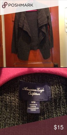 American eagle sparkle flyaway Flyaway type cardigan. Chunky knit is very warm. Dark gray with the little bit of sparkle. Excellent condition free of rips or stains. American Eagle Outfitters Sweaters Cardigans