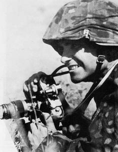 WAFFEN SS soldier with camera, Operation Barbarossa in Russia.