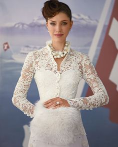 Wedding dress inspired by Zurich, Switzerland. Lovely lace and fur muff.