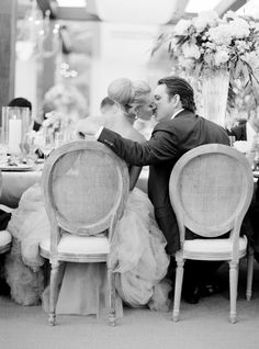 Gorgeous wedding photograph--black and white. Bride + groom + kiss. It looks so photojournalistic and lovely. (And the bride's hair and (Vera Wang) wedding gown are lovely.) Photograph: Jose Villa.