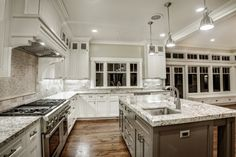 Interior Design For Kitchen Backsplash With Mini Pendant Light Above Marble Island And White Cabinet Also Using Wall Tiles