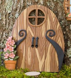 "Miniature Fairy Garden Double Door Tree Accent: Hang our Miniature Windows and Double Door on a tree to encourage local elves and garden fairies to come and go through your yard. With their tiny shutters and detailed window boxes full of flowers, our Set of Two Windows add a homey touch to miniature gardens. The Double Door with its scrolled ""hinges,"" handles and little window, adds a fun, fanciful touch to any fairy garden. Beautifully painted, detailed resin fairy accents are…"