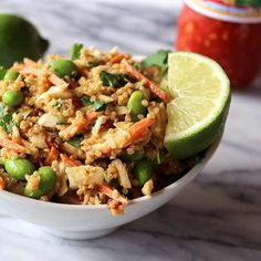 Thai quinoa chicken salad with edamame, shredded carrots, and a spicy peanut sauce. A perfect side salad to bring to a summer BBQ!