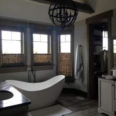 Bath Masters Naperville modern master bath with separate vanities and ribbon skylights