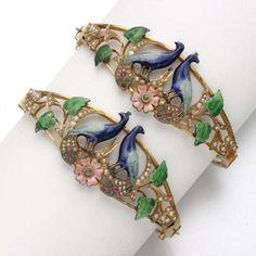 Art Nouveau Jewelry bronze bracelets with symmetrical  blue enamel peacocks green leaves and vine scrolls