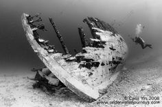 How to photograph wrecks underwater using ambient light, strobes, and black and white techniques. Includes examples of close-focus wide angle wreck photography.