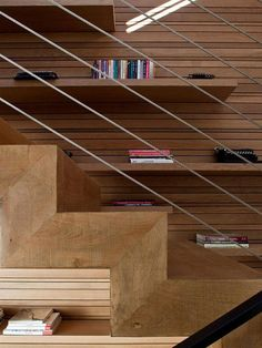 Contemporary Ramat Hasharon House 6 (Photo 26) Wooden Stairs with Wall Library Shelves