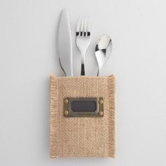 Complete your table setting with our exclusive silverware pouches, woven of 100% jute with a natural hue and texture and outfitted with nameplates for your dinner guests.