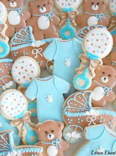 baby shower cookies in soft blue and brown - rattles, onesies, bears