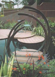 Bespoke hand forged rotating sculpture & furniture for medal-winning show garden at Tatton Park www.ironvein.co.uk #steel #ribs #sculpture #show #garden