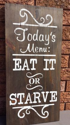 "KITCHEN SIGN/EAT OR STARVE MENU SIGN/HUMOROUS SIGNS/GAG GIFT/HOUSEWARMING GIFT/MOTHERS DAY GIFT WOOD SIGN IN A DARK WALNUT STAIN AND WHITE PAINT WITH SEALANT ADDED. CLAW TOOTH HANGER IS INSTALLED. MEASUREMENTS: 24"" X 11 1/2"" 3/4"" THICK CONTACT: kimbercreations@outlook.com"