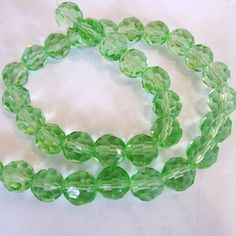 10mm Peridot Green Faceted Glass Round 34 by BeadFindingUtopia, $1.99