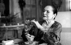 'American magnate Helena Rubinstein, sitting at a laid table, has just finished a frugal meal in the luxurious dining room of her house on the Fifth Avenue