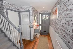 grey and white hallway with exposed brick style walls White Brick Walls, Grey Brick, Grey Walls, Grey And White Hallway, Small Hallways, Rustic Shabby Chic, Hallway Decorating, Exposed Brick, Built In Storage