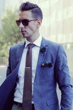 Blue Blazer, white shirt, brown tie, green lapel flower camo pocket square