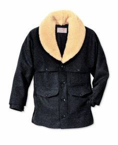 """Few coats in Filson's lineup can turn on the heat like a Wool Packer  Coat. Its 24.oz. Mackinaw wool stops blustery wind and icy cold dead in their tracks. A 100% natural  sheepskin shawl collar provides additional softness and warmth. Adjustable button cuffs.  Center back length:  33-1/2"""".  Sizes:  38-50.  Colors:  Charcoal, Red/Black."""