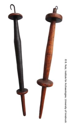 """Spanish double-whorl-spindles with iron hook at the tip from the province of Zaragoza. This type of spindle is mainly used for plying. Lengths with hook: 12.6"""" and 12.8"""". Whorl diameters: 1.53"""" (upper whorl of left spindle), 1.33"""" (lower whorl of left spindle), 1.85"""" (upper and lower whorl of right spindle)."""