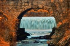 Beautiful fall scenery with waterfall peaking through stone arches and autumn colors in the surrounding area. Wonderful Places, Beautiful Places, Milford Connecticut, Moving Companies, Missing Home, Close To My Heart, Beautiful Sunset, Summer 2014, Great Artists