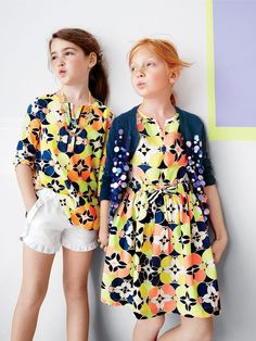 J.Crew girls' tunic in kaleidoscopic floral, pull-on ruffle short and gumball necklace with flowers. J.Crew girls' iridescent bubble cardigan sweater and picnic dress in kaleidoscopic floral.