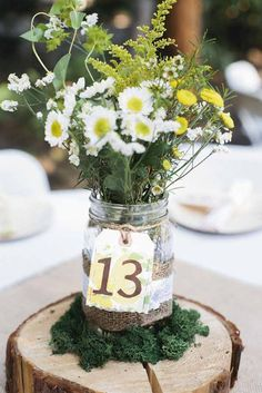 Rustic centerpiece:  Dip the mason jar in chalk paint and include feathers