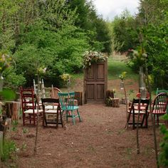 Angela and Damon used mismatched chairs, tree stumps and an antique door for a charming woodland wedding ceremony.