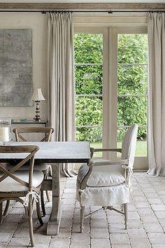 floor + wood trim + wall length window treatment