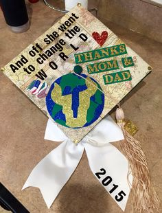 World/Travel inspired grad cap from USF