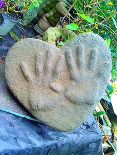 Sand-Cast Garden Stones with your Children's and Pets hand and foot prints! SImple and Cheap to Create!