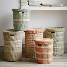 Made from woven natural and dyed abaca twine, these Striped Baskets add texture and playful shades to your bedroom or bathroom.