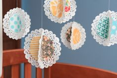 doily mobile with fabric! @Amanda Snelson Snelson Rios
