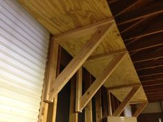 Picture of Heavy Duty Shelf Brackets   Make your own using 2 x 4 lumber and screws. Each bracket cost me less than $3.