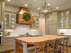 Reclaimed barnwood meets high-end design in this contemporary country-inspired kitchen.