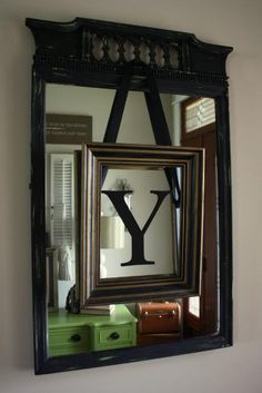 Redo an old mirror -- love the frame and letter layered on the mirror.