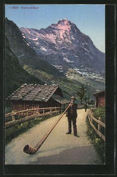 alte-AK-Alphornblaeser-Mann-mit-Alphorn-auf-dem-Feldweg-vor-der-Berghuette